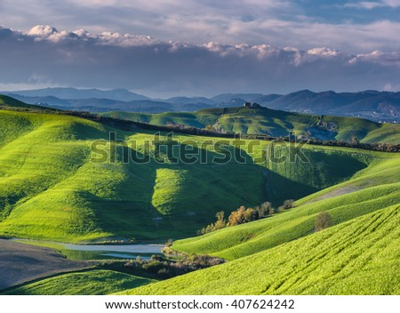 Warm and sunny days in the Crete Senesi, Tuscan landscape - stock photo