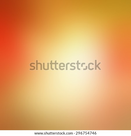 warm autumn background blur in red pink gold yellow and orange with white center and smooth shiny background texture, colorful background design - stock photo