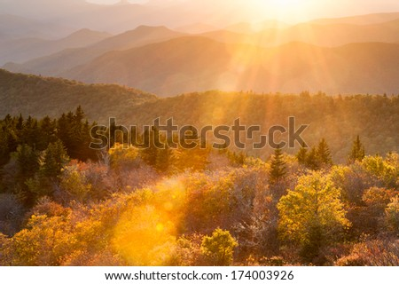 Warm Autumn Sunshine Flares over a Southern Appalachian Landscape in Western North Carolina - stock photo
