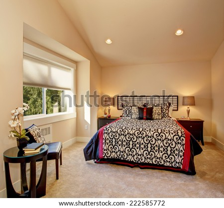 Warm bedroom with high vaulted ceiling Bed with japanese style bedding - stock photo