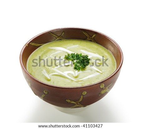 Warm Bowl of Cream Of Broccoli Soup. Garnished with Cream and Green Parsley - stock photo