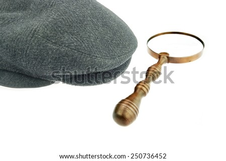 Warm Cap with Earflaps and Magnifying Glass Isolated on White Background - stock photo