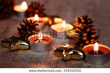 Warm Christmas holiday candles in home interior - stock photo