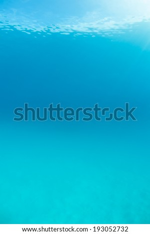 Warm, clear, blue water fills a sandy lagoon in the tropical Western Pacific. - stock photo