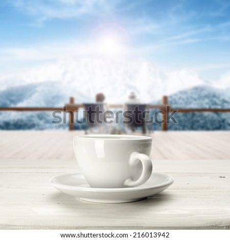 warm coffee cup and winter space of mountain  - stock photo