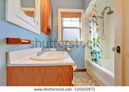 Warm colorful bathroom interior with old-fashioned ceramic appliances in tudor style home. Northwest, USA