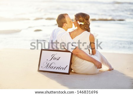 warm colors of evening wedding on the beach - stock photo