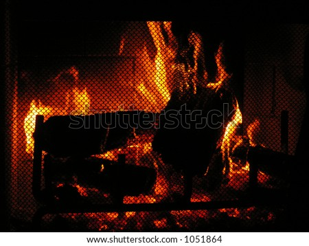 Warm fire on a winter's evening - stock photo