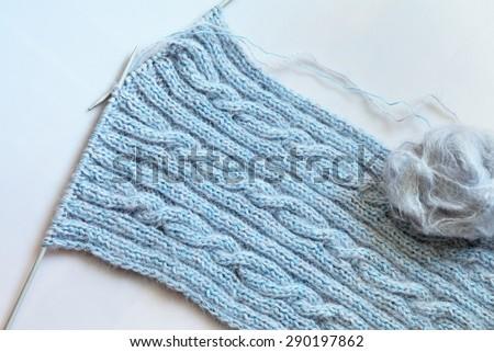 Warm fluffy woolen scarf. Hand knitting - stock photo