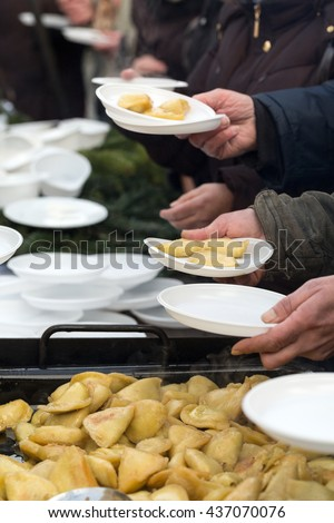 Warm food for the poor and homeless - stock photo