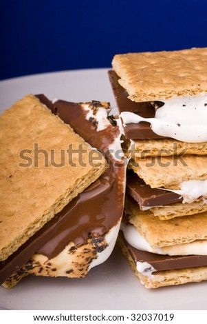 warm freshly home made smores on a white plate - stock photo