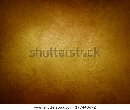 warm gold brown background, black vignette border and light center, abstract vintage grunge background texture, earthy country western tone, beautiful bronze background color, product display backdrop - stock photo