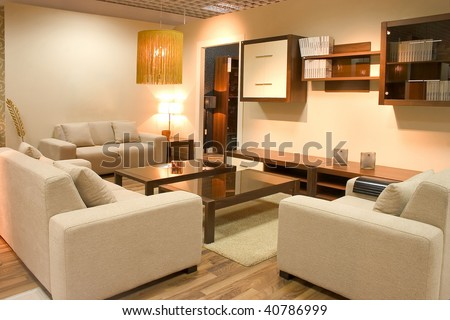 Warm interior of cosy living room with white sofas and tables. - stock photo