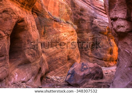 Warm light from around the corner in Buckskin Gulch, the longest slot canyon in the in world, in the Paria Canyon / Vermillion Cliffs WIlderness, near the Utah-Arizona border. - stock photo