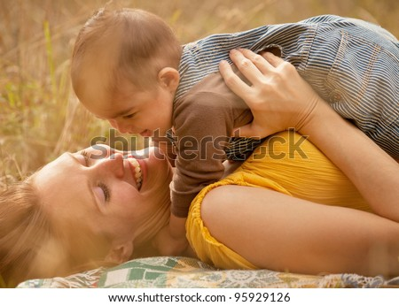 Warm Loving Mother and Son Smiling Close Up - stock photo
