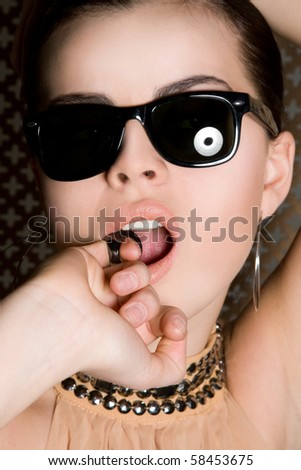 Warm portrait of a seductive lady with accessories - stock photo