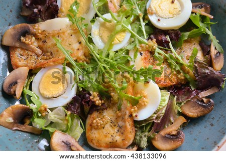 warm salad with chicken breast, mushrooms, egg and fresh arugula.