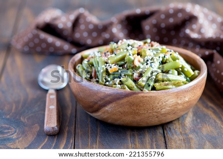 Warm salad with green beans and bacon - stock photo