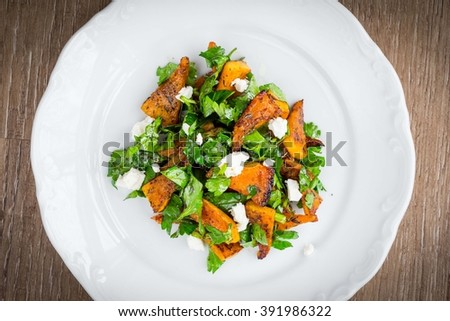 Warm salad with roasted pumpkin, parsley, spinach, feta, healthy food for diets - stock photo