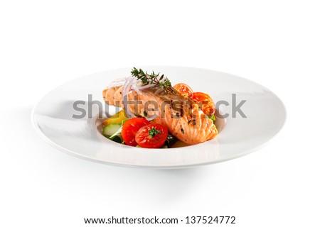 Warm Salad with Salmon Steak - stock photo