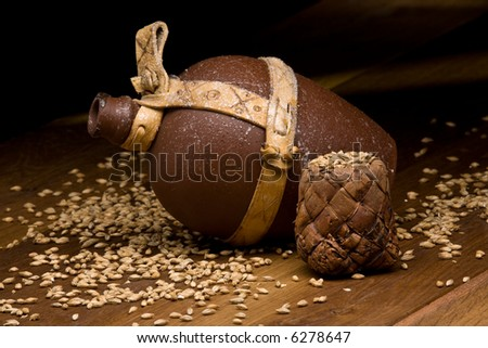 warm scene with malt and clay jug on a table - stock photo