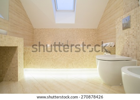 Warm sophisticated bathroom with marble floor - stock photo