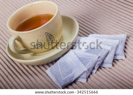 warm tea in a cup and tea pot in the side no paper - stock photo