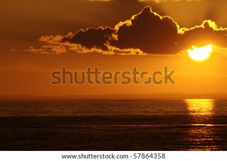 Warm weather sunset with cloud. Baikal lake, Russia.