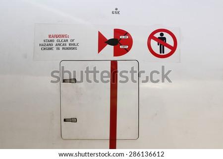 Warning Danger Sign On Jet Engine - stock photo