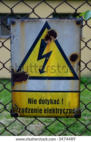 Warning ! electric installation - old polish sign - stock photo
