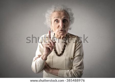 Warning grandmother - stock photo