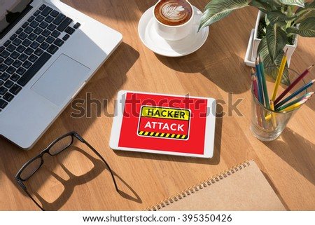Warning Hacker Attack Browsing Concept on tablet on screen, table and coffee Business - stock photo