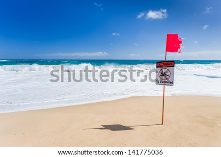 Warning no swimming sign with strong sea wave by the beach background - stock photo
