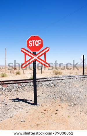 Warning of road sign - stop and railway of the road, Namibia - stock photo