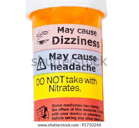 Warning on prescription bottle about nitrates and erectile dysfunction tablets - stock photo