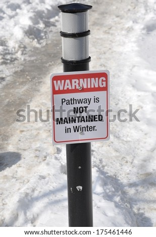 Warning pathway is not maintained in winter signage - stock photo