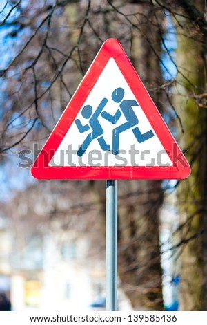 Warning road s Sign kids installed on sections of roads where possible sudden appearance of childrenign - Caution children! - stock photo