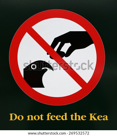 Warning Sign Do not feed the Kea - New Zealand - stock photo