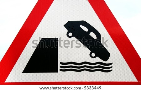 Warning Sign -- for cars not to get too close to the water - stock photo