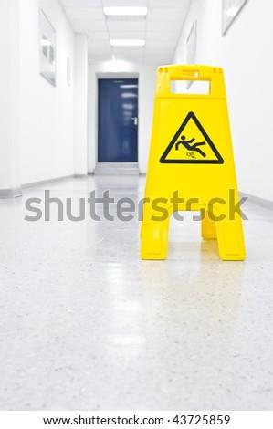 Warning sign for slippery floor - stock photo