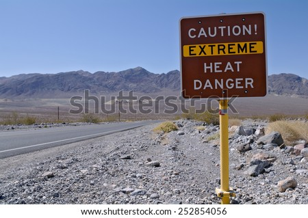 Warning sign in Death Valley National Park (California, USA). Death Valley National Park is known for dangerously high temperatures in summer. - stock photo