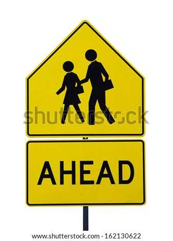 Warning sign of pedestrians crossing road ahead near school - stock photo