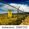 Warning sign on a fence surrounding the Trinity Site in New Mexico where the first nuclear bomb was exploded - stock photo