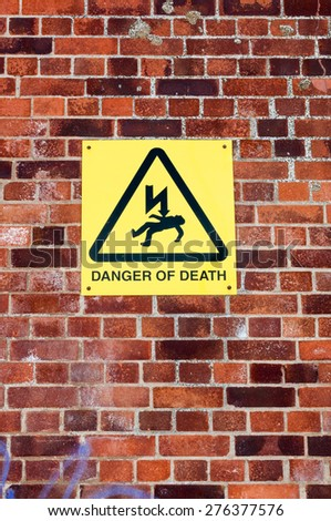 Warning sign on a wall 'Danger of Death' - stock photo