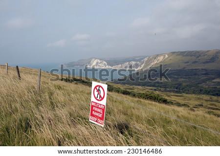 Warning sign on Dorset Coastal path near Tyneham - stock photo