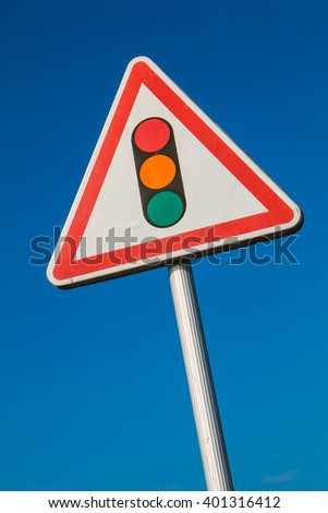 warning sign with a picture of a traffic signal on blue sky - stock photo