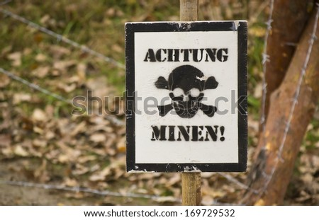 warning sign with German text Watch out mines - stock photo