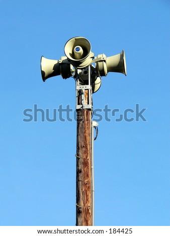 Warning siren on a pole - stock photo