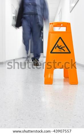 Warning slip hazard - stock photo