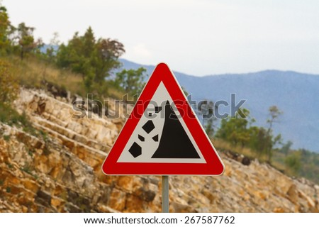 Warning Stone Fall Road Sign On Mountain Road Road sign warning about rockfall